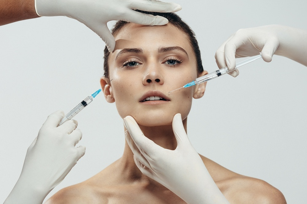 Woman getting multiple facial injections