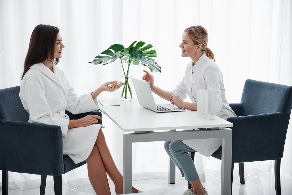 Dermatologist Speaking with Woman