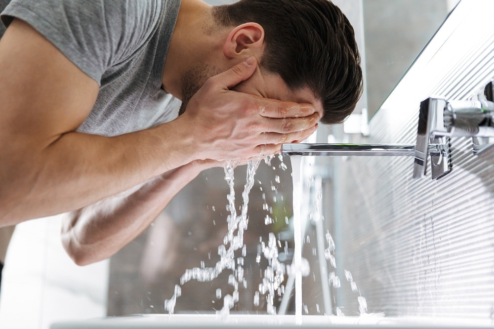 Man Washes Face