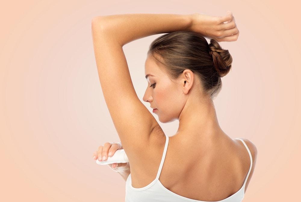 Putting on deodorant