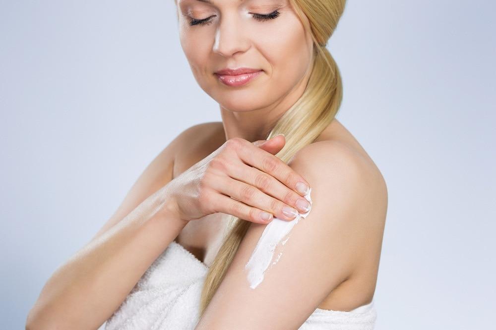 Lady Applying Cream to Arm